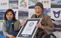Masazo Nonaka of Japan (R), aged 112, receives a certificate for the Guinness World Records' oldest male person living title from Erika Ogawa (L), vice president of Guinness World Records Japan, in Ashoro. Picture: AFP.