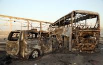 A general view show burnt out vehicles after gunmen and suicide car bombers killed dozens of people in two assaults claimed by Islamic State group jihadists near the southern Iraqi city of Nasiriyah on 14 September 2017. Picture: AFP