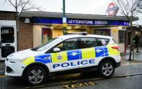 FILE: A police car outside Leytonstone station in north London on 6 December 2015. Police were called to reports of people being attacked at Leytonstone the day before. Picture: AFP.