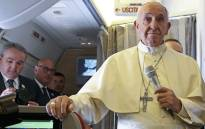 FILE: Pope Francis addresses journalists aboard the plane for his trip to Chile and Peru, on 15 January 2018. Picture: AFP.