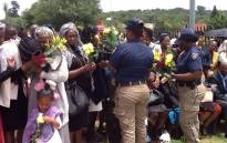 Emotional scenes as family and JMPD colleagues say goodbye at the scene of a crash in Fourways. Picture: Mia Lindeque/EWN