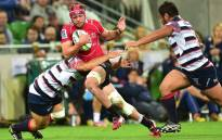 FILE: Lions captain Warren Whiteley (C) is tackled during the round six Super Rugby match between Melbourne Rebels and The Lions at AAMI Park in Melbourne, Australia, 20 March 2015. Picture: EPA