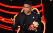 Trevor Noah accepts the best host award for 'The Daily Show' onstage during the 2017 MTV Movie And TV Awards on 7 May 2017 in Los Angeles, California. Picture: AFP