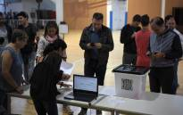 People set up a polling station in Sarria de Ter, where Catalan president will vote, on October 1, 2017, on the day of a referendum on independence for Catalonia banned by Madrid. Picture: AFP.