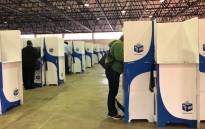 Voting delegates at the Democratic Alliance's federal congress cast their ballots in Tshwane. Picture: EWN.