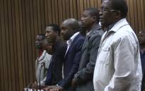 Screengrab of eight former police officers convicted of the murder for Mozambican taxi driver Mido Macia.