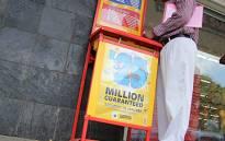 A man fills in a lotto form outside a lotto stand in Pretoria. Picture: Taurai Maduna/EWN