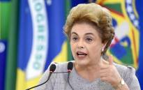 FILE: Former Brazilian President Dilma Rousseff delivers a speech during meeting with a group of jurists and lawyers who came to the Planalto Palace in Brasilia to provide support in 22 March, 2016. Picture: AFP