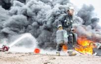 A firefighter battles a blaze at a Durban warehouse. Picture: Netcare 911.
