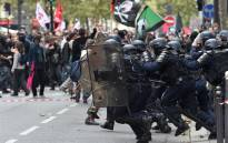 Anti-riot police charge protesters on the sidelines of a demonstration on 10 October 2017 in Paris, part of a nationwide strikes and demonstrations against the French president's bid to transform the public service. Picture: AFP