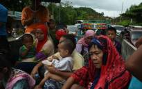 Residents fleeing from Marawi city,where gunmen who had declared allegiance to the Islamic State group rampaged through the southern city, are cramped on a truck as they traverse a traffic gridlock near a police checkpoint at the entrance of Iligan City, in the southern island of Mindanao on 24 May 2017. Picture: AFP.