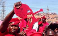 FILE: An EFF supporter holds up a symbol of the party at their official launch in Marikana on 13 October 2013. Picture: Reinart Toerien/EWN.