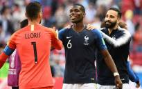 France's goalkeeper Hugo Lloris, France's midfielder Paul Pogba and France's defender Adil Rami celebrate at the end of the Russia 2018 World Cup Group C football match between France and Australia at the Kazan Arena in Kazan on 16 June, 2018. Picture: AFP