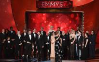 Writer/producers David Benioff and D.B. Weiss (both center-left, at microphone) with 'Game of Thrones' cast onstage during the 68th Annual Primetime Emmy Awards. Picture: Getty Images/AFP.