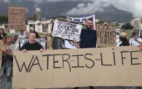 Members of Save Water and Stop COCT express their concerns about the City of Cape Town's water and electricity tariff proposals. Picture: Kaylynn Palm/EWN.