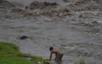 A resident tries to catch fish along a river near Mayon volcano in Daraga town, Albay province, south of Manila on January 27, 2018. Millions of tonnes of ash and rocks from an erupting Philippine volcano are threatening to bury surrounding communities due to heavy rain, authorities warned. Picture: AFP