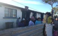 Residents stand at the site where a house fire killed six people in Bonteheuwel on 26 October 2016. Picture: Lauren Isaacs/EWN.