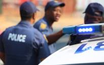 FILE: Police gather on the streets surrounding Kya Sand as community members protested over service delivery in the area on 12 October 2015. Picture: Reinart Toerien/EWN.