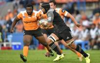 FILE: The Crusaders' Jordan Taufua runs with the ball past The Toyota Cheetahs' Ox Nche (L) during the SUPERXV rugby union match between The Cheetahs and The Crusaders at the Bloemfontein rugby stadium in Bloemfontein on April 29, 2017. Picture: AFP.