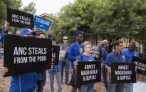 Protesters are seen outside the Bloemfontein Magistrates Court on Thursday 15 February 2018 as suspects linked to the Estina dairy farm made an appearance at the court. Picture: Ihsaan Haffejee/EWN.