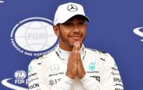 FILE: Mercedes' British driver Lewis Hamilton celebrates winning the pole position after the qualifying session at the Autodromo Nazionale circuit in Monza on 2 September 2017 ahead of the Italian Formula One Grand Prix. Picture: AFP.