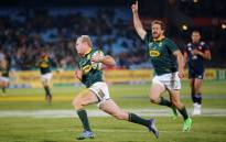 Springbok scrumhalf Ross Cronje runs in to score a try. Picture: AFP
