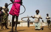 FILE: Children play with hula hoops at the Children Friendly Space, run by Unicef. Picture: AFP.