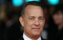 FILE: US actor Tom Hanks arrives on the red carpet for the BAFTA British Academy Film Awards at the Royal Opera House in London on 16 February 2014. Picture: AFP.