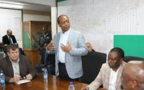 Harmony Gold Chairperson Patrice Motsepe speaking alongside Mineral Resources Minister Mosebenzi Zwane and union leaders at a briefing about the deaths of five miners at Kusasalethu mine on 1 September 2017. Picture: Twitter/@DMR_SA.