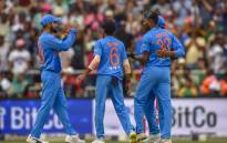 India celebrate the fall of a wicket. Picture: AFP
