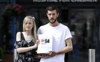 Connie Yates (L) and Chris Gard, parents of terminally-ill 10-month-old Charlie Gard, pose with a petition of signatures supporting their case on 9 July 2017. Picture: Picture: AFP.