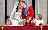 FIEL: Britain's Prince William kisses his wife Kate, Duchess of Cambridge, on the balcony of Buckingham Palace, after the wedding service, on 29 April, 2011, in London. Picture: AFP