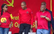 YCLSA National Secretary Cde Mluleki Dlelanga, centre, alongside Central Committee member Cde Zingiswa Losi and SACP leader Blade Nzimande on stage during Red October Centenary celebrations in Durban. Picture: @SACP1921/Twitter.