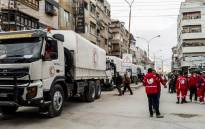 The Syrian Red Crescent and the United Nations deliver an aid convoy to Al-Nishabieh in Rural Damascus, Syria. The convoy carried relief items of food parcels, flour, nutrition, medicines and medical materials for 1,440 families there. Picture: Twitter/ @SYRedCrescent