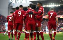Liverpool players celebrate as the team beat West Ham 4-1 0on Saturday 24 February 2018. Picture: Twitter/@LFC
