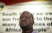 Dewa Mavhinga, Southern Africa Director with the African Division at Human Rights, address the recent resignation by President Robert Mugabe at the Zimababwe Solidarity Forum in Braamfontein. Picture: Thomas Holder/EWN