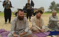 FILE: Swede Johan Gustafsson (L), South African Stephen McGowan (C) and Dutch national Sjaak Rijke (R) held captive by al-Qaeda. Picture: AFP