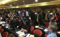 FILE: Students raise their hands  and want to make submissions during the fees commission. Picture: Barry Bateman/EWN.
