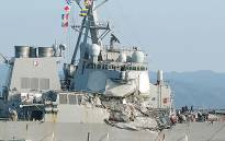 A handout photo from Japan Coast Guard and taken on 17 June 2017 shows damages on the guided missile destroyer USS Fitzgerald after it collided with a Philippine-flagged container ship. Picture: AFP.