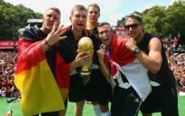 Germany players (L-R) Bastian Schweinsteiger, Per Mertesacker, Manuel Neuer, Kevin Grosskreutz and Lukas Podolski celebrate with the World Cup trophy. Picture: Official DFB Facebook Page.