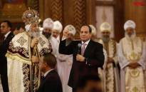 President Abdel Fattah al Sisi is seen with the head of the Coptic Church, Pope Tawadros II, during a mass on the eve of Coptic Christmas. Picture: @EgyptTodayMag/Twitter.