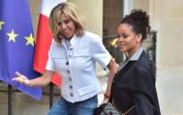 Brigitte Macron (L), wife of the French president, welcomes Barbadian musician and Global Ambassador for the Global Partnership for Education Rihanna at the Elysee Palace in Paris on 26 July 2017. Rihanna is the founder of the Clara Lionel Foundation campaigning for education rights in impoverished communities worldwide. Picture: AFP.