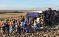 People and rescuers carry an injured woman after a train accident at Corlu district in Tekirdag, on 8 July, 2018. Picture: AFP.