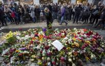 A woman lays flowers to commemorate the victims of an terror attack at a makeshift memorial near the site where a truck drove into a department store in Stockholm, Sweden, on. Picture: AFP