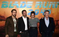 US actors Harrison Ford (R) and Ryan Gosling (L) pose with Cuban actress Ana De Armas (2nd R) and Canadian director Denis Villeneuve (2nd L) during a photocall for the film 'Blade Runner 2049' in Paris on 20 September 2017. Picture: AFP