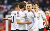 FILE: Manchester United captain Wayne Rooney celebrates a goal with his teammates. Picture: Manchester United official Facebook page