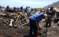 FILE: Masiphumelele residents rebuild following a shack fire. Picture: Shamiela Fisher/EWN.