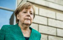FILE: German Chancellor Angela Merkel leaves the Reichstag housing the Bundestag (lower house of parliament) after a meeting with the leadership of her conservative Christian Democratic Union (CDU) party on 14 June 2018 in Berlin. Picture: AFP.
