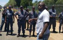 Police form a line to separate protesters from parents outside Hoërskool Overvaal in Vereeniging as protests outside the school continue on 19 January 2018. Picture: Ihsaan Haffejee/EWN