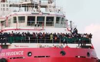 The Italian rescue ship Vos Prudence run by NGO Medecins Sans Frontieres (MSF) arrives in the early morning of 14 July 2017, in the port of Salerno carrying migrants rescued from the Mediterranean sea. Picture: AFP.